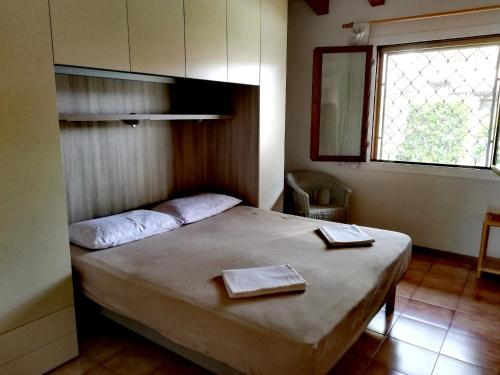 A bed or beds in a room at Signora Ruth - Aprilia Residence