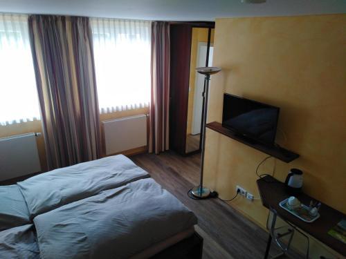 Ein Bett oder Betten in einem Zimmer der Unterkunft Die Krone