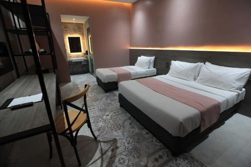 A bed or beds in a room at Zenvea Hotel