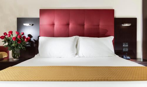 A bed or beds in a room at Terminal Palace & SPA