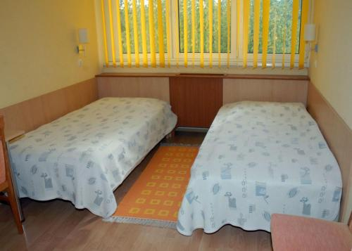 A bed or beds in a room at Sport Hotel
