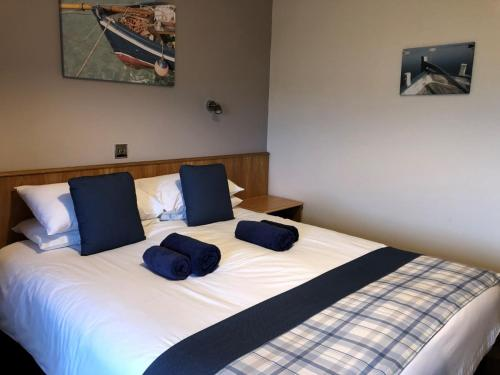 A bed or beds in a room at St Columba Hotel