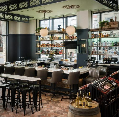 A restaurant or other place to eat at Perry Lane Hotel, a Luxury Collection Hotel, Savannah