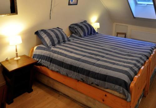 A bed or beds in a room at Vakantiehuis Vijlen