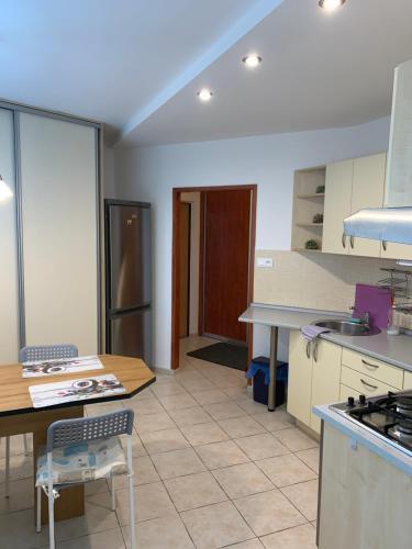 Kuchyňa alebo kuchynka v ubytovaní Apartament T&Hos