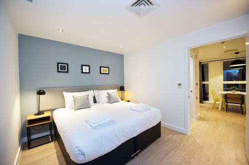 A bed or beds in a room at Staycity Aparthotels Birmingham Central Newhall Square