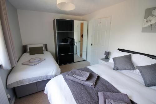 A bed or beds in a room at Hinckley Home Sleeps 7 Complete house