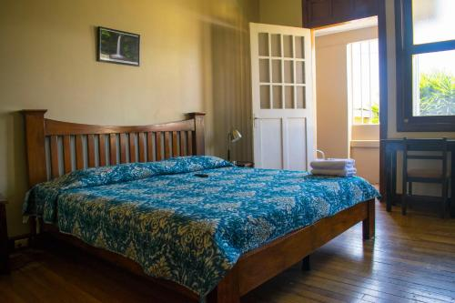 A bed or beds in a room at Costa Rica Guesthouse