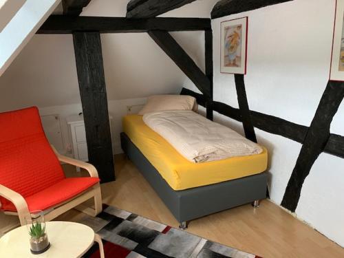 Ein Bett oder Betten in einem Zimmer der Unterkunft Gästehaus Windheim (Karlsruher Denkmal)