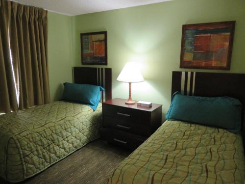 A bed or beds in a room at Surfsider Resort - A Timeshare Resort