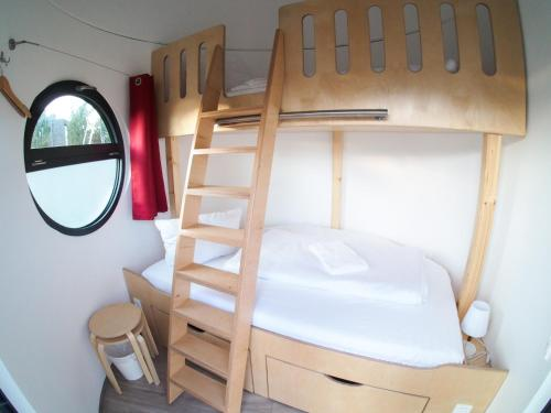 A bunk bed or bunk beds in a room at slube Yachthafen Greifswald