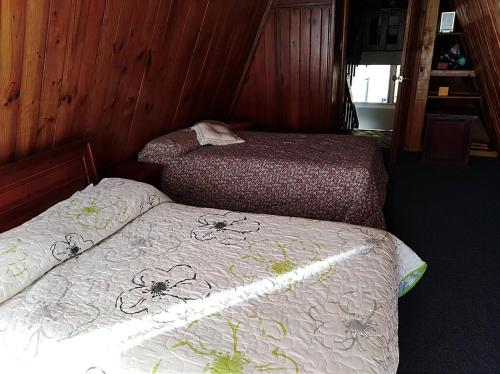 A bed or beds in a room at CHALET LOS PINOS