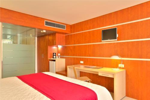 Een bed of bedden in een kamer bij Torarica Resort