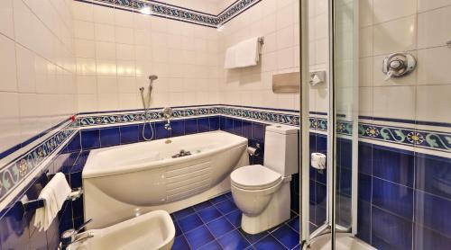 Koupelna v ubytování Hotel Mozart