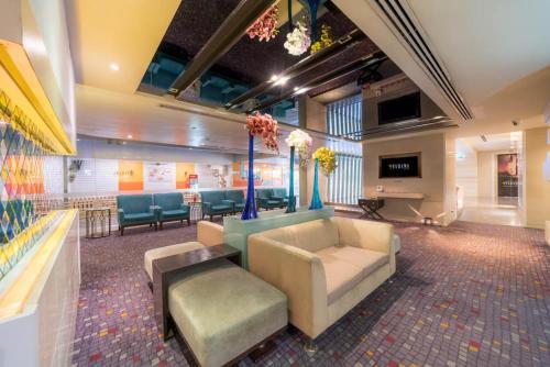 The lobby or reception area at Furama Silom Hotel