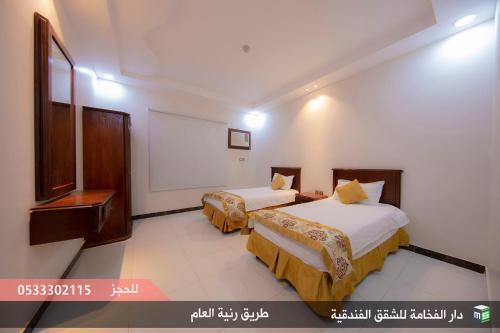 Cama ou camas em um quarto em دار الفخامة رنية