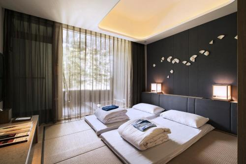 A bed or beds in a room at Wellspring by Silks