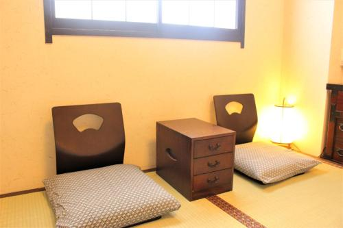 A bed or beds in a room at K's House Tokyo Oasis - Asakusa Downtown