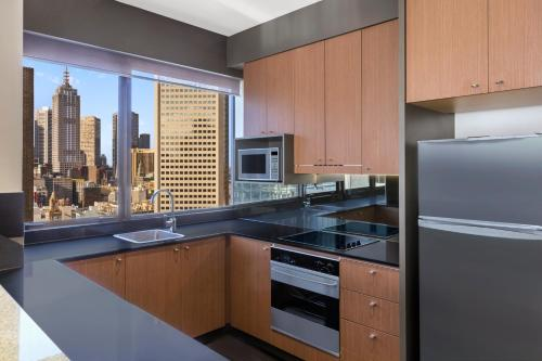 A kitchen or kitchenette at Adina Apartment Hotel Melbourne