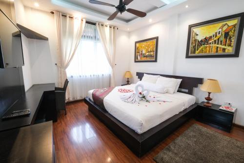 A bed or beds in a room at Le Domaine de Cocodo