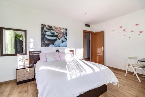 Cama o camas de una habitación en Atico Escapada a Granada