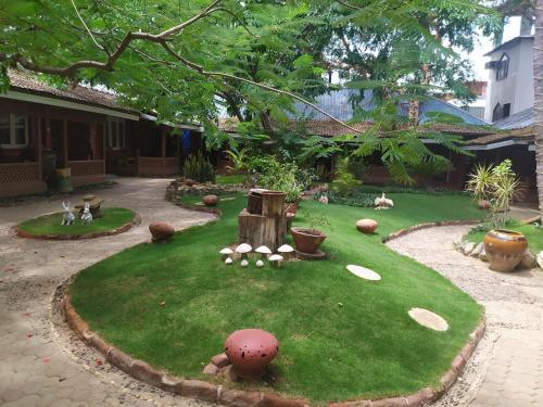 A garden outside Kaday Aung Hotel