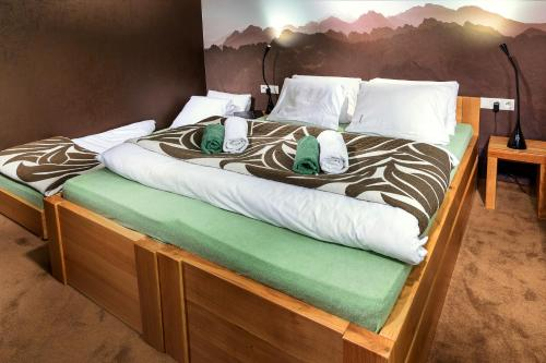 A bed or beds in a room at Vila Emma