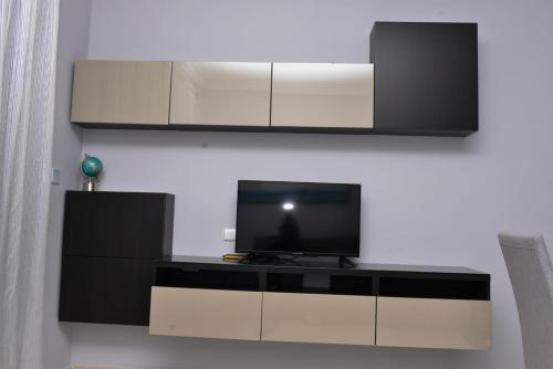 A television and/or entertainment centre at SWEET DREAM