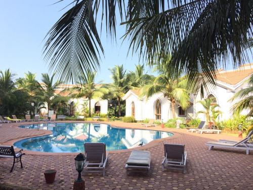 The swimming pool at or near Casa Legend Villa & Apartments Arpora - Baga - Goa