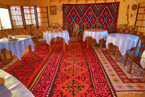 A restaurant or other place to eat at Happy Nomads Yurt Camp & Hostel