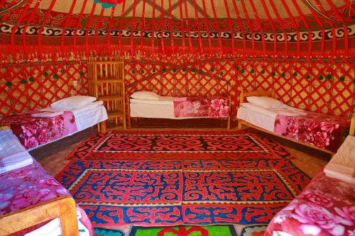 A bed or beds in a room at Happy Nomads Yurt Camp & Hostel