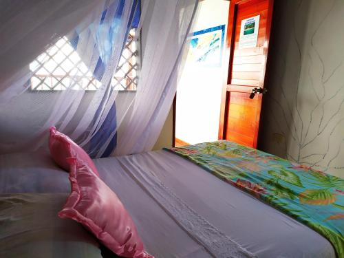 A bed or beds in a room at Hostel Blue Sea Rincon del Mar