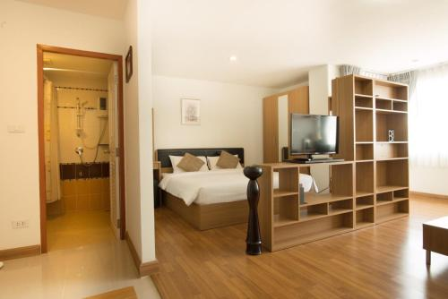 A bed or beds in a room at Winner Serviced Apartment
