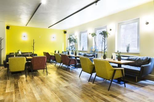 A restaurant or other place to eat at Five Reasons Hostel & Hotel