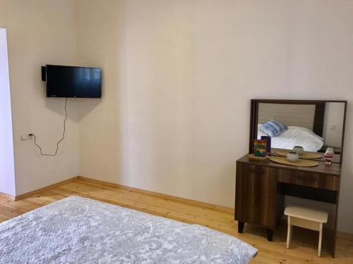 Uma TV ou centro de entretenimento em Sweet dream