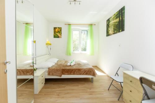 Posteľ alebo postele v izbe v ubytovaní Apartment Green Forest