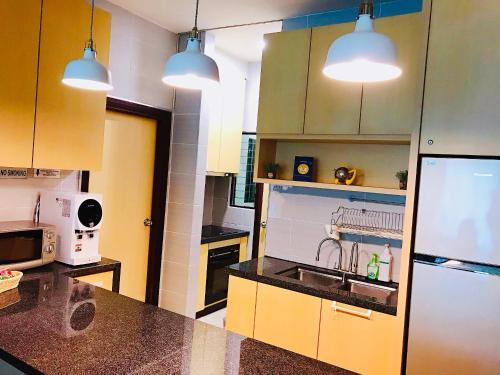 A kitchen or kitchenette at Imperial Grand Suite Apartment
