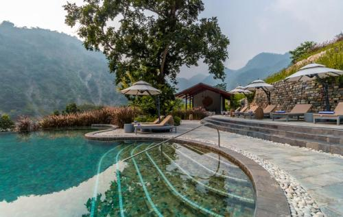 The swimming pool at or near Taj Rishikesh Resort & Spa Uttarakhand