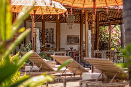 A restaurant or other place to eat at United Colors of Gili