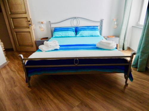 A bed or beds in a room at LE GIÜE