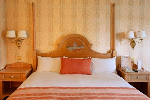 A bed or beds in a room at Disneyland® Hotel