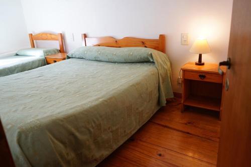Una cama o camas en una habitación de Apart Flavia
