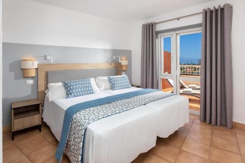 Een bed of bedden in een kamer bij Sol Barbacan