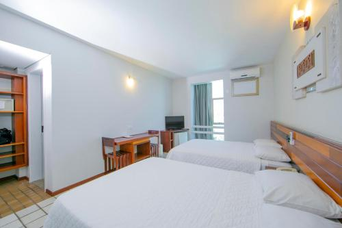 A bed or beds in a room at Falls Galli Hotel