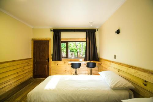 A bed or beds in a room at Kalfu Patagonia