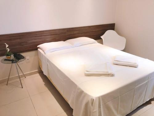 A bed or beds in a room at Angra Praia Hotel