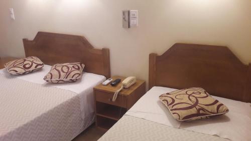 Uma cama ou camas num quarto em Hotel Alicante