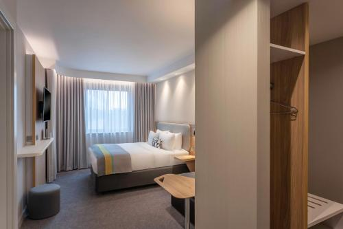 A bed or beds in a room at Holiday Inn Express Dublin-Airport, an IHG Hotel