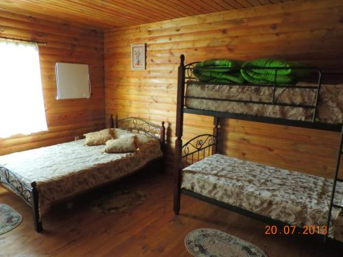 A bed or beds in a room at Slavutich