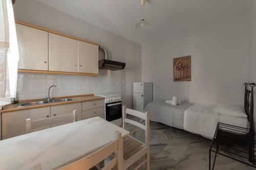 A kitchen or kitchenette at Aphrodite Hotel & Apartments